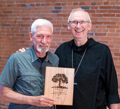 Kroll receives Tegeder Award from Abbott John